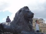 children playing on one of the Trafalgar Square lions